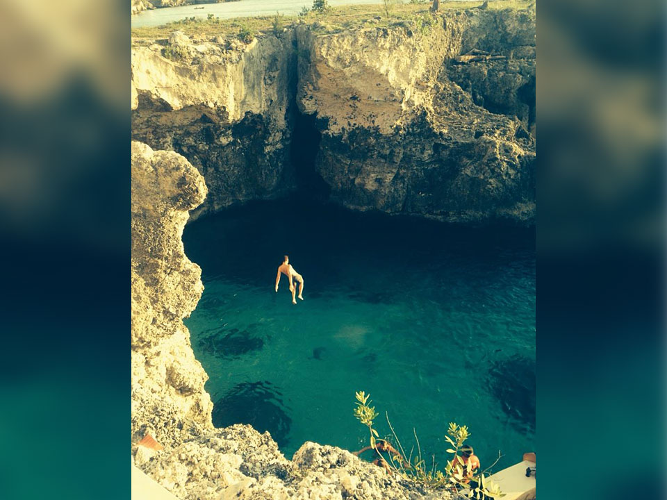 About Page - Cliff jumping in Jamaica